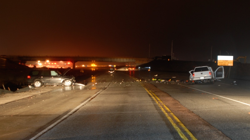 Pictures released to the court show the scene of a crash between a black Ford Expedition and white pick-up truck on Highway 17 Thursday, March 31, 2011.