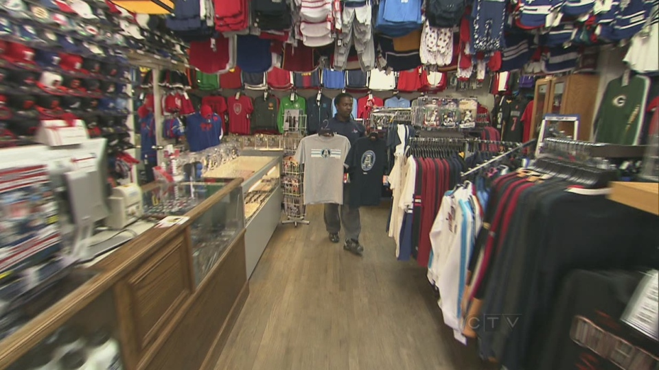 Local retailer Tex Thomas is pictured in his sporting goods store in Toronto, Nov. 20, 2012. Local businesses say they are looking forward to the increased crowds the 100th Grey Cup will bring to the city.