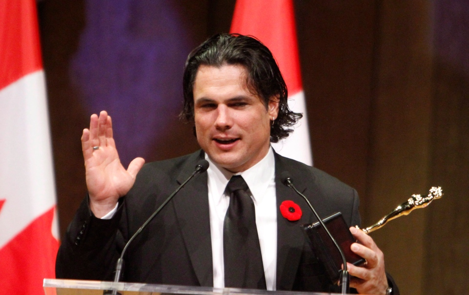 Senator Patrick Brazeau accepts the Bad Sport Award at the National Press Gallery Dinner Saturday in Gatineau, Quebec, Saturday, Nov. 3, 2012. (Fred Chartrand / THE CANADIAN PRESS)