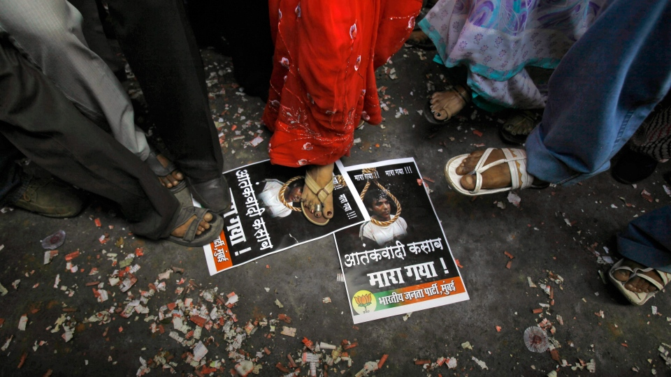 Activists of India's main opposition Bharatiya Janata Party (BJP) stamp on portraits of Mohammed Ajmal Kasab to celebrate the news of his execution, in Mumbai, India, Wednesday, Nov. 21, 2012.  (AP / Rafiq Maqbool)