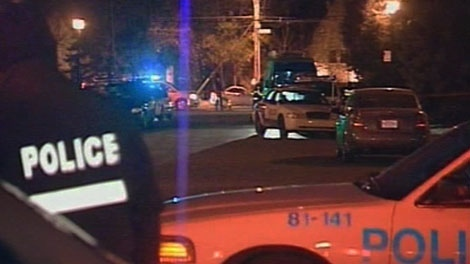 A police vehicle blocks access to Gouin Blvd. in Cartierville, Que., after Nicolo Rizzuto was shot and killed in his home on Wednesday, Nov. 10, 2010.