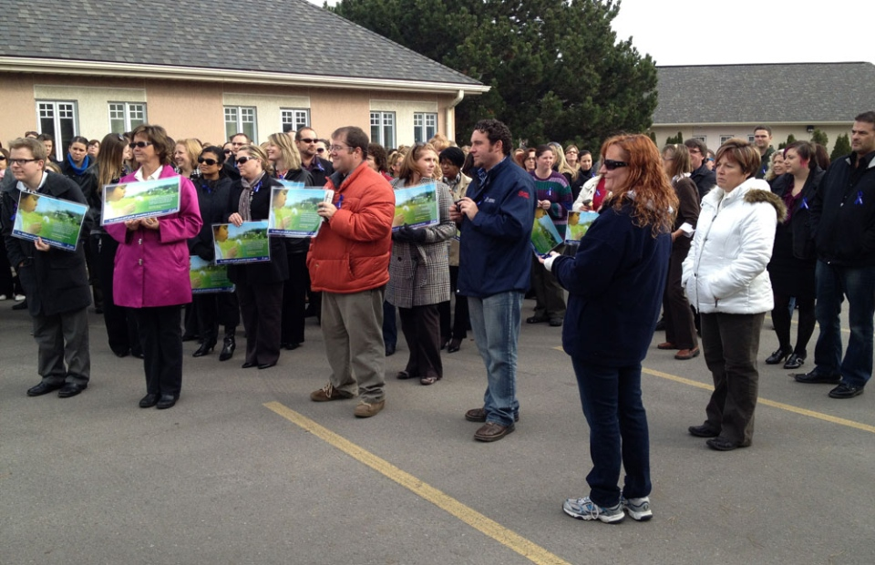 Workers at Family and Children's Services of Waterloo Region hold a rally over service cuts in Kitchener, Ont. on Tuesday, Nov. 20, 2012. (David Imrie / CTV Kitchener)