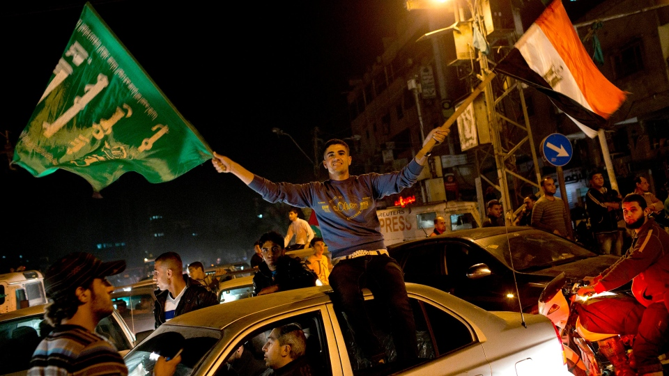 Palestinians celebrate the cease-fire between Hamas and Israel in Gaza City, Wednesday, Nov. 21, 2012. (AP / Bernat Armangue)