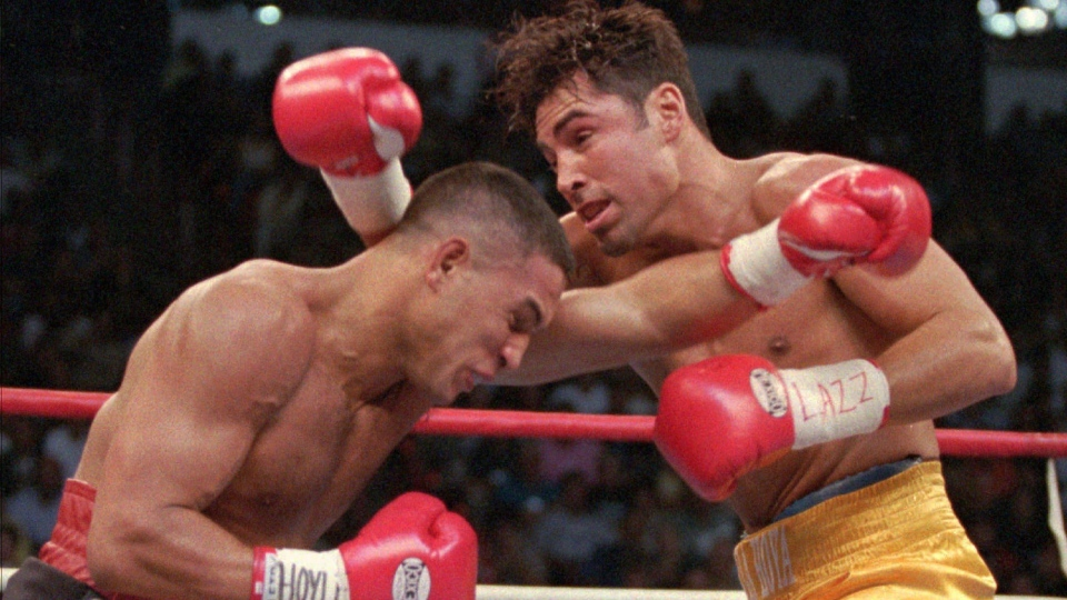 Hector Camacho, left, of Puerto Rico, and Oscar De La Hoya of Los Angeles exchange blows in the first round of their WBC welterweight championship in Las Vegas in this Sept. 13, 1997 file photo. (AP / Mike Salsbury)