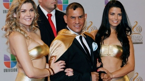 "In this Feb. 16, 2012 file photo former boxing champion Hector ""Macho"" Camacho, front center, poses for photographers at his arrival to the Premio Lo Nuestro Music Awards in Miami. (AP / Alan Diaz, File)"