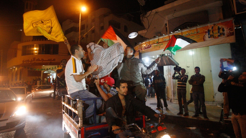 Palestinians celebrate the cease-fire agreement between Israel and Hamas in Gaza City, Wednesday, Nov. 21, 2012. (AP / Adel Hana)