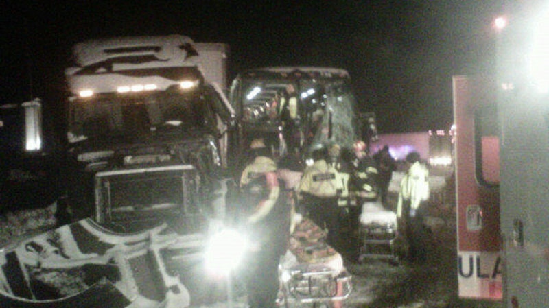 Authorities respond to a multi-vehicle crash involving a tour bus and a semi truck on the Coquihalla Highway. Nov. 21, 2012. (CTV)