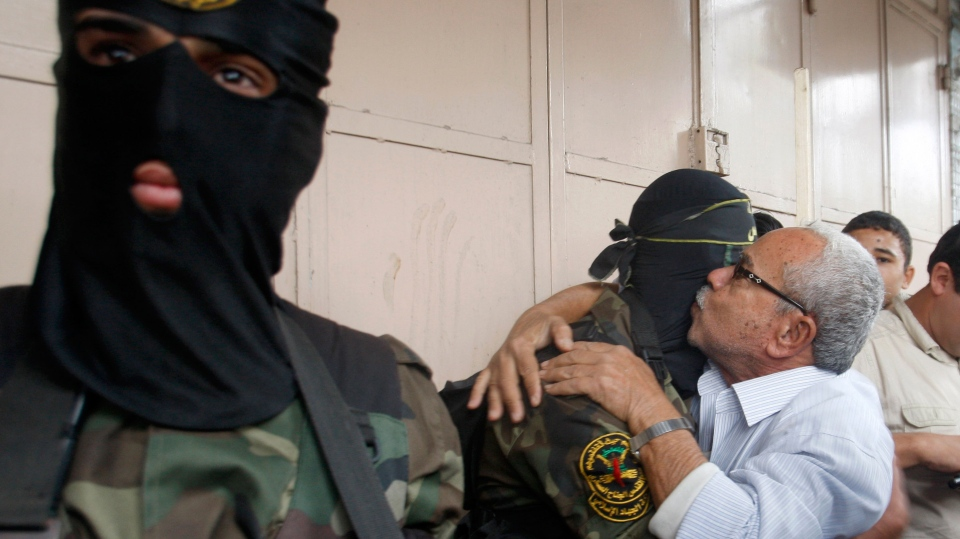 A Gaza man hugs a Palestinian Islamic Jihad militant after a press conference in Gaza City, Thursday, Nov. 22, 2012. (AP / Hatem Moussa)