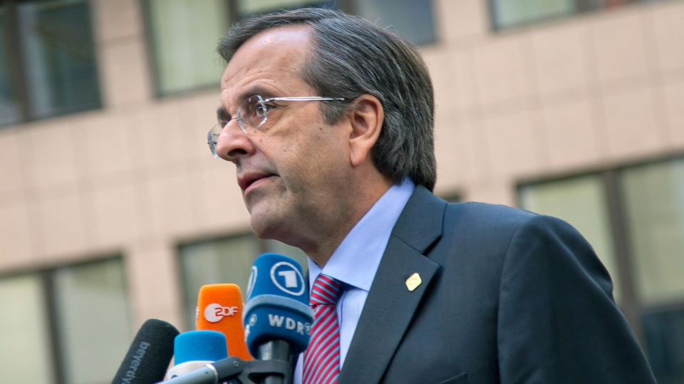 Greek Prime Minister Antonis Samaras speaks with the media as he arrives for an EU summit at the EU Council building in Brussels on Thursday, Nov. 22, 2012. (AP / Virginia Mayo)