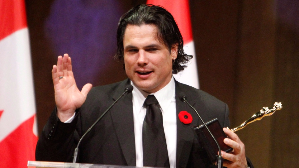 Senator Patrick Brazeau accepts the Bad Sport Award at the National Press Gallery Dinner Saturday in Gatineau, Quebec, Saturday November 3, 2012. (Fred Chartrand / THE CANADIAN PRESS)