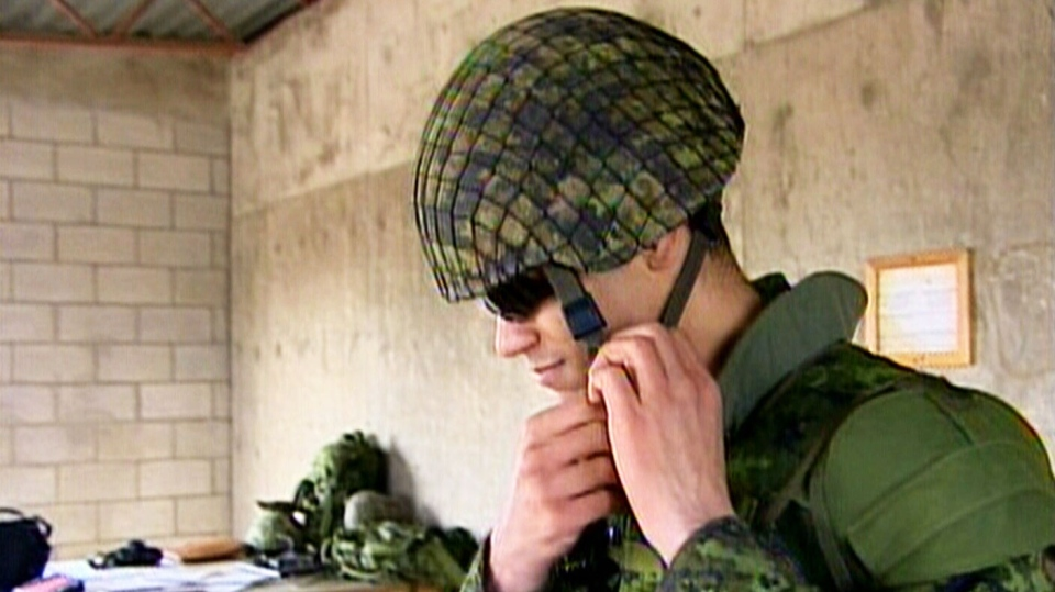 A Canadian reservist prepares for a training exercise at Canadian Forces Base Wainwright in Denwood, Alberta.