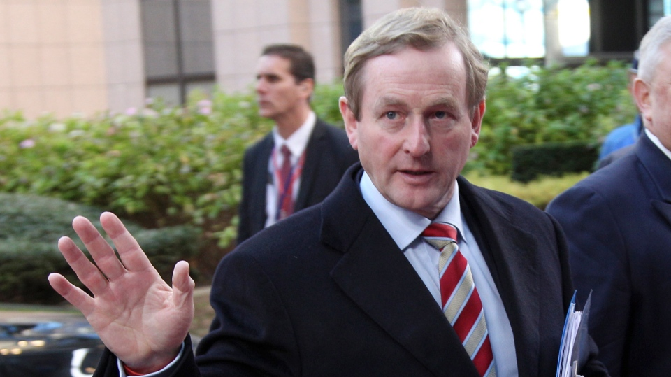 Irish Prime Minister Enda Kenny waves to the media as he arrives for an EU summit at the EU Council building in Brussels on Thursday, Nov. 22, 2012. (AP / Yves Logghe)