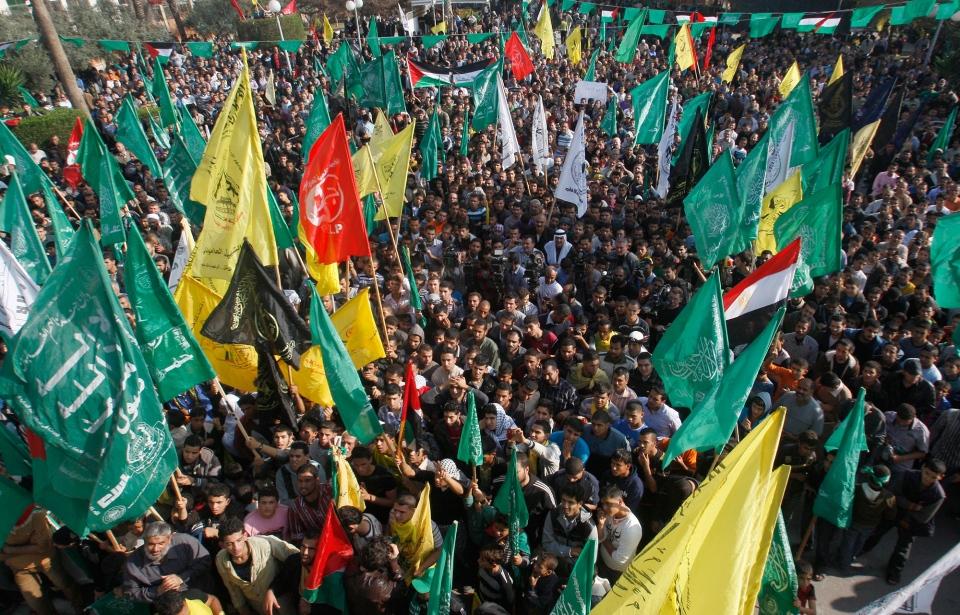 Palestinians celebrate the Israel-Hamas cease-fire in Gaza City on Nov. 22, 2012. (AP / Hatem Moussa)