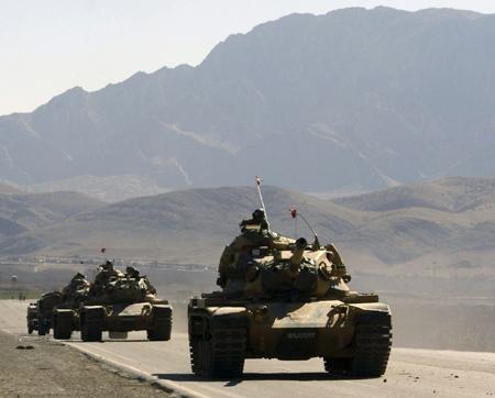 Turkish army tanks are seen near the Turkish-Iraqi border town of Silopi in the Sirnak province, southeastern Turkey on Friday, Feb. 22, 2008. (AP / Mehmet Ersoy, Cihan News Agency)