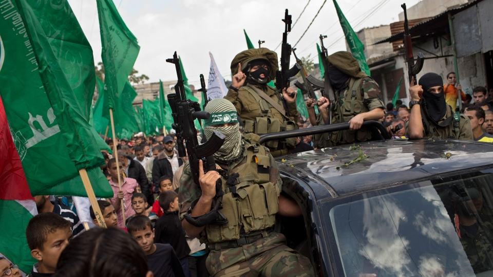 Palestinian Hamas militants parade during a rally to celebrate the Israel-Hamas cease-fire in the Jebaliya refugee camp, north Gaza Strip, Thursday, Nov. 22, 2012. (AP / Bernat Armangue)
