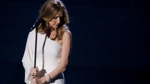 Celine Dion reacts to the audience during her opening night performance at Caesar's Palace in Las Vegas, March 2011. (AP Photo/Julie Jacobson)