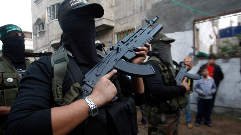 Hamas militants stand during a Hamas press conference in Gaza City, Thursday, Nov. 22, 2012. (AP / Hatem Moussa)