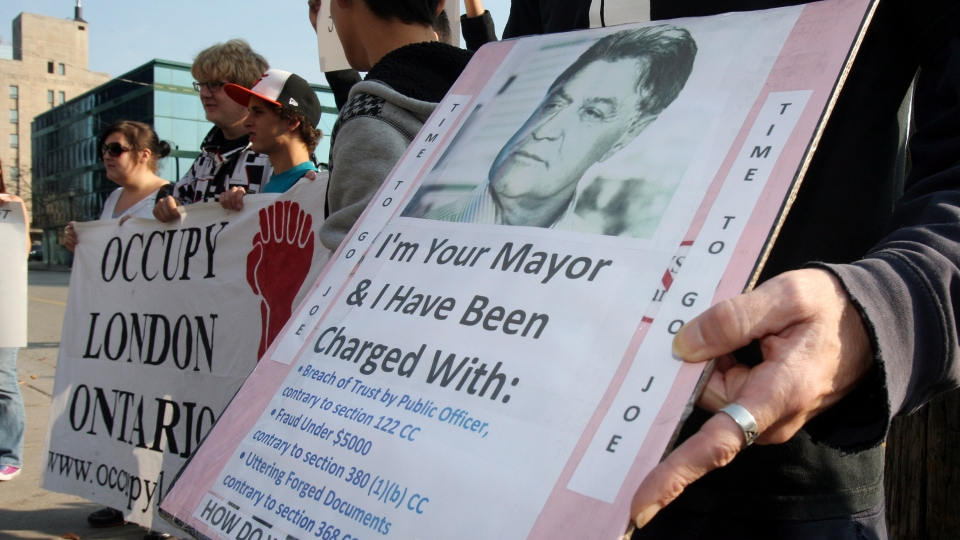 Protesters gather outside as Mayor Joe Fontana makes a statement about charges he is facing after an RCMP investigation during a news conference in London, Ont., on Thursday, Nov. 22, 2012. (Dave Chidley / THE CANADIAN PRESS)