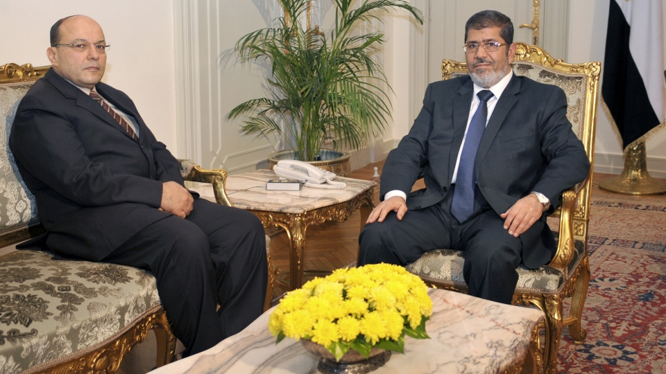 Egyptian President Mohammed Morsi, right, poses for a photograph with his new Prosecutor General, Talaat Abdullah, left, in Cairo, Egypt, Thursday, Nov. 22, 2012. (AP / Egyptian Presidency)