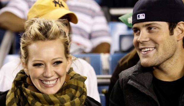 Actress and singer Hilary Duff, left, attends the New York Yankees' baseball game against the Chicago White Sox with New York Islanders center Mike Comrie at Yankee Stadium in New York, Tuesday, Sept. 16, 2008.