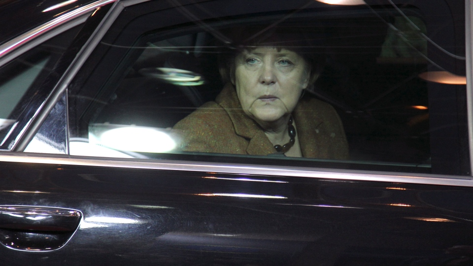 German Chancellor Angela Merkel looks out of her car window as she arrives for an EU summit in Brussels on Thursday, Nov. 22, 2012. (AP / Yves Logghe)