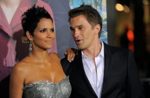 Halle Berry, left, poses for reporters with Olivier Martinez at a premiere at Grauman's Chinese Theatre in Los Angeles on Wednesday, Oct. 24, 2012. (Chris Pizzello / Invision)