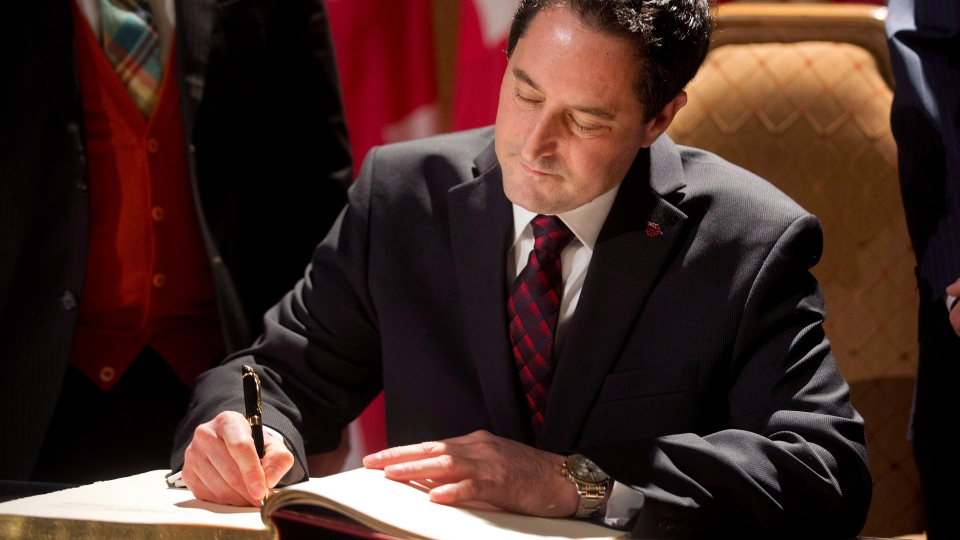 Michael Applebaum signs his name during a ceremony in Montreal, Monday November 19, 2012, where he became interim mayor of Montreal. THE CANADIAN PRESS/Graham Hughes