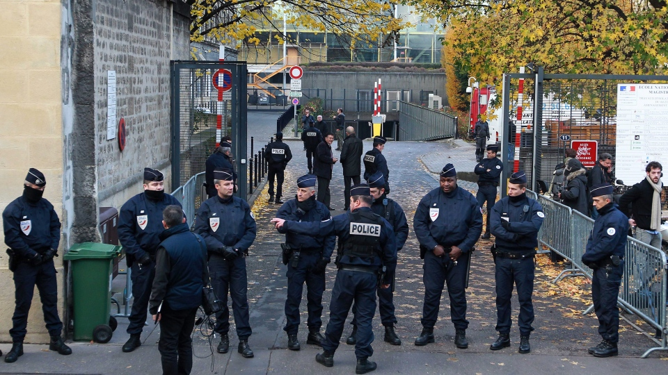 French police officers take their positions at one of the main entrances of the courthouse after former French President Nicolas Sarkozy arrived, in Bordeaux, France, Thursday, Nov. 22, 2012. (AP / Bob Edme)