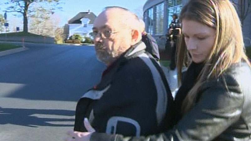John Leonard MacKean is seen with his daughter leaving a court in Bridgewater, N.S. in this image from video, Thursday, Nov. 22, 2012.
