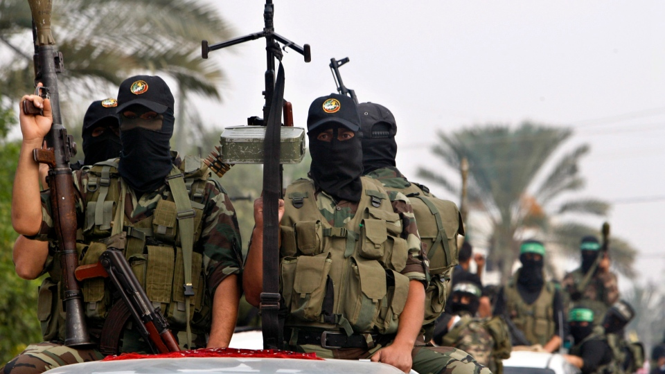 Palestinian militants of the Izzedine Al-Qassam Brigades, the armed wing of Hamas, attend funerals of five Hamas militants in Mugharka village, central Gaza Strip, Thursday, Nov. 22, 2012. (AP / Adel Hana)