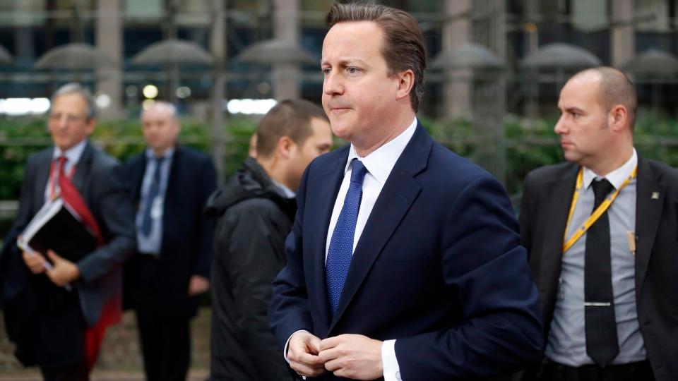 British Prime Minister David Cameron, center, arrives for an EU summit in Brussels on Friday, Nov. 23, 2012. (AP / Michel Euler)