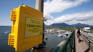 A suicide prevention phone is seen on the Iron Workers Memorial Bridge in North Vancouver Thursday, May 10, 2012. (Jonathan Hayward / THE CANADIAN PRESS)