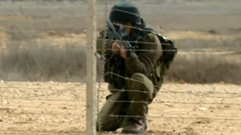 Israeli troops shot dead a Palestinian man and wounded nine along Gaza's border fence with Israel on Friday, Nov. 23, 2012.