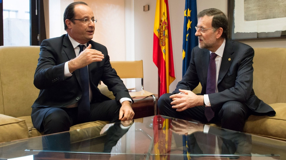 French President Francois Hollande, left, participates in a bilateral meeting with Spain's Prime Minister Mariano Rajoy on the sidelines of an EU summit in Brussels on Friday, Nov. 23, 2012. (AP / Bertrand Langlois)