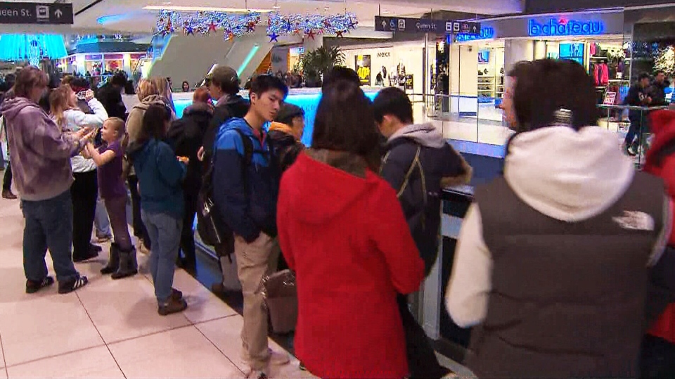 Bargain hunters line up at the Toronto Eaton Centre to search for Black Friday deals Friday, Nov. 23, 2012.