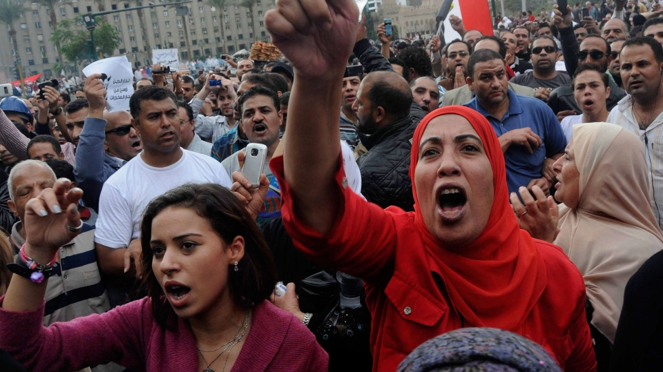 Egyptian protesters opposed to president Mohammed Morsi chant slogans in Tahrir Square in Cairo, Egypt, Friday, Nov. 23, 2012. (AP / Mohammed Asad)
