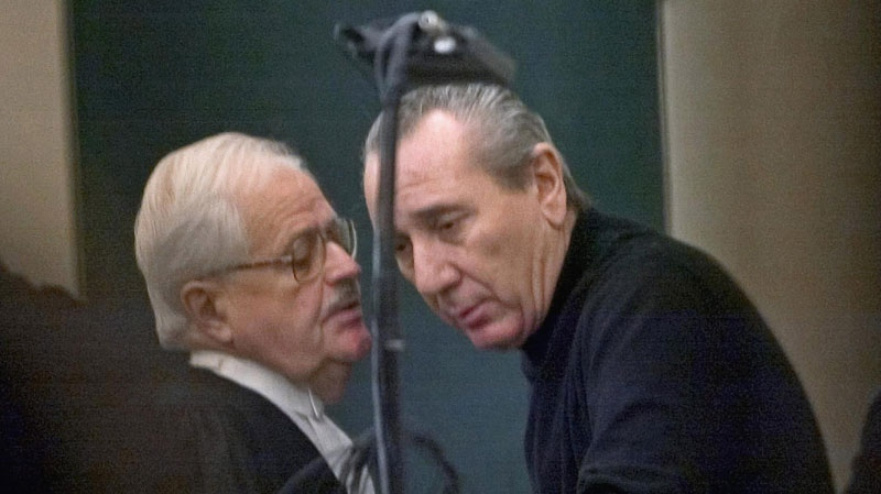 Vito Rizzuto (right), speaks with his attorney Jean Salois after his hearing in Montreal, Friday, Feb. 6, 2004. (Ryan Remiorz / THE CANADIAN PRESS)