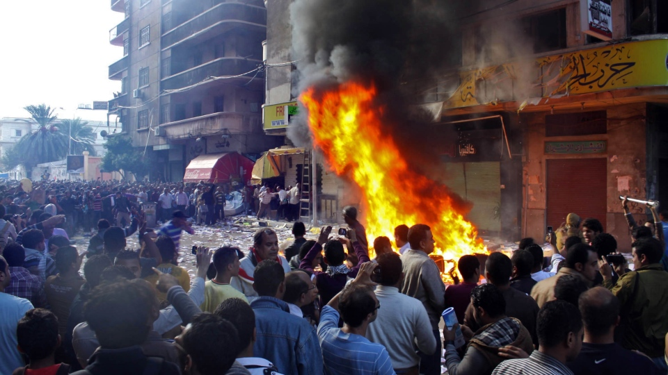 Protesters storm an office of Egyptian President Mohammed Morsi's Muslim Brotherhood Freedom and Justice party and set fires in the Mediterranean port city of Alexandria, Egypt, Friday, Nov. 23, 2012. (Amira Mortada, El Shorouk Newspaper)
