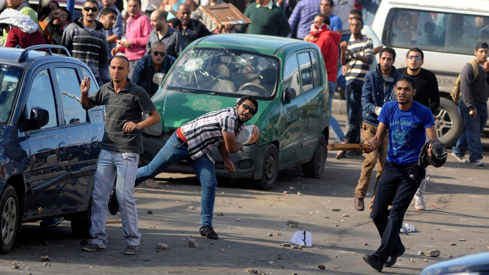 Protesters hurl stones during clashes between supporters and opponents of President Mohammed Morsi in Alexandria, Egypt, Friday, Nov. 23, 2012. (AP / Tarek Fawzy)