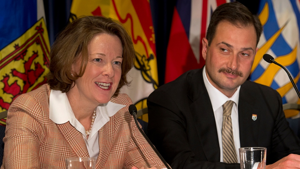 Alberta Premier Alison Redford, left, fields a question as Prince Edward Island Premier Robert Ghiz looks on at the closing news conference of the premiers' economic summit in Halifax on Friday, Nov. 23, 2012. (Andrew Vaughan / THE CANADIAN PRESS)