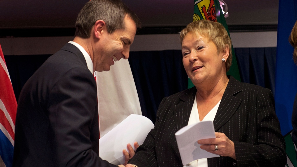 Quebec Premier Pauline Marois, right, chats with Ontario Premier Dalton McGuinty at the end of the premiers' economic summit in Halifax on Friday, Nov. 23, 2012. (Andrew Vaughan / THE CANADIAN PRESS)