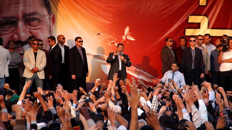 Egyptian President Mohammed Morsi speaks to supporters outside the Presidential palace in Cairo, Egypt, Friday, Nov. 23, 2012. (AP / Aly Hazaza, El Shorouk)