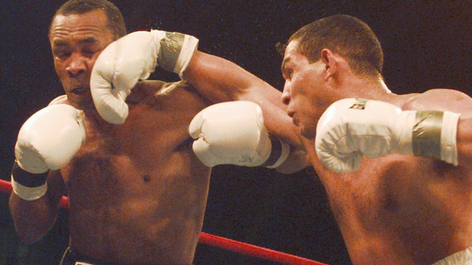 "Hector Camacho exults as referee Joe Cortez stops the fight with ""Sugar"" Ray Leonard in the fifth round in Atlantic City, N.J., March 1, 1997. (AP / Charles Rex Abrogast)"