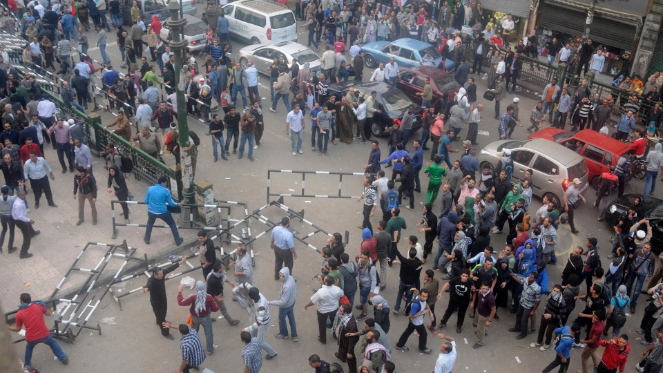 Egyptian protesters gather outside the country's high court in Cairo, Egypt, Saturday, Nov. 24, 2012. (AP / Mohammed Asad)