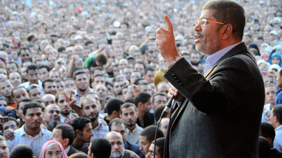 Egyptian President Mohammed Morsi speaks to supporters outside the Presidential palace in Cairo, Egypt, Friday, Nov. 23, 2012. (AP / Egyptian Presidency)