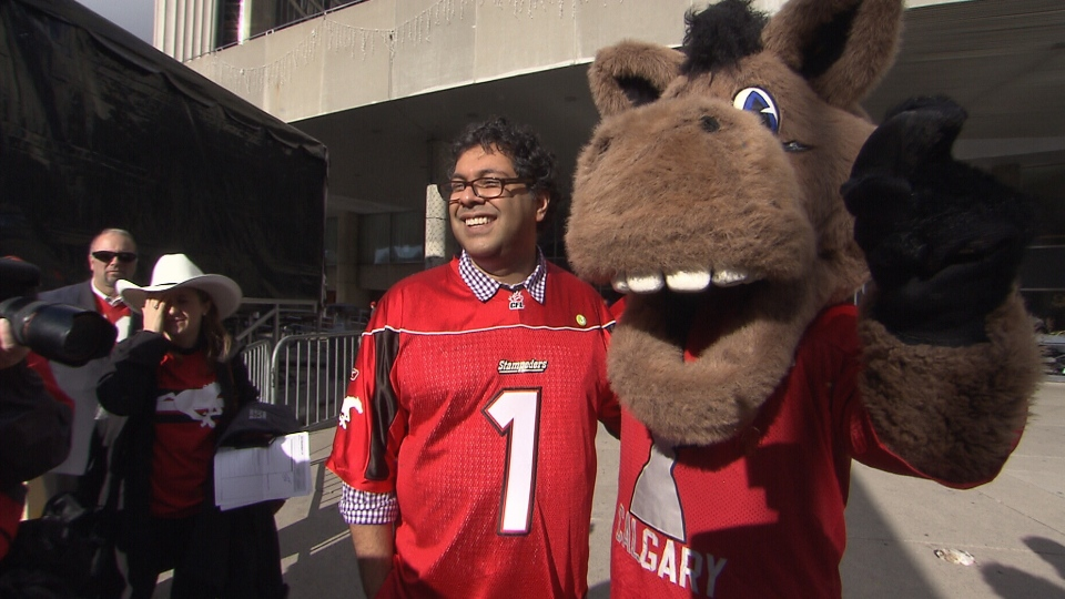 Calgary Mayor Naheed Nenshi poses with the mascot of the Calgary Stampeders ahead of the 100th Grey Cup in Toronto, Saturday, Nov. 24, 2012.