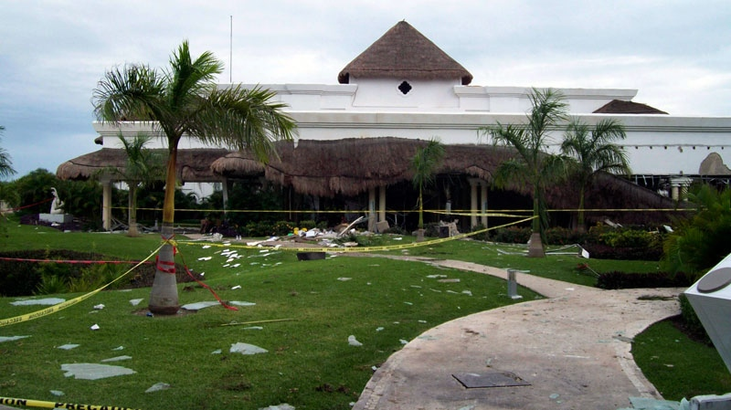 Debris is seen scattered in the lawn of the Grand Riviera Princess Hotel in Playa del Carmen, Quintana Roo state, Mexico, Sunday Nov. 14, 2010. (AP)