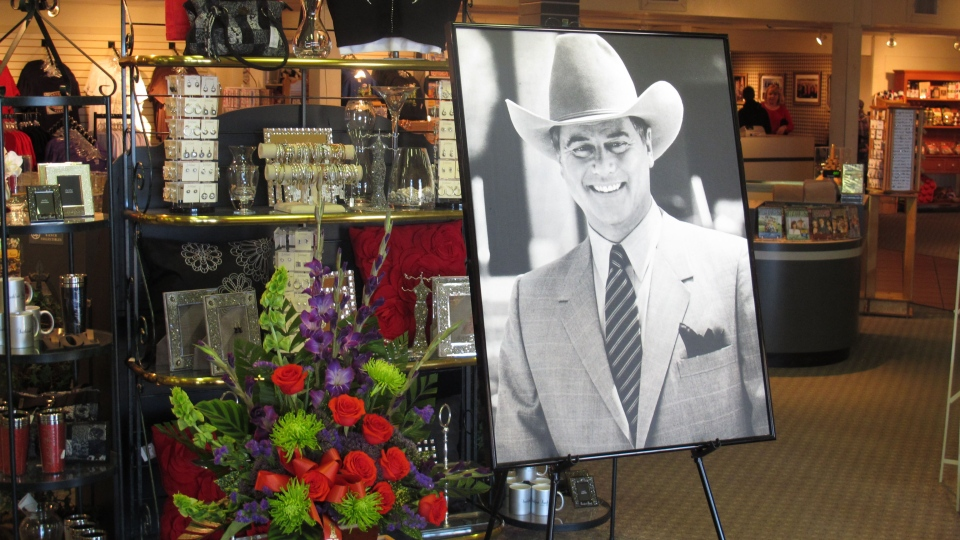 A large portrait of Larry Hagman can be seen by a bouquet of flowers at the entrance of the gift shop at Southfork Ranch on, in Parker, Texas, Saturday, Nov. 24, 2012. (AP / Angela K. Brown)