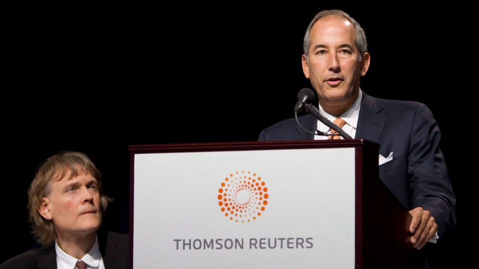 Thomson Reuters CEO Thomas Glocer, right, speaks as Chairman David Thomson looks on in Toronto, May 3, 2011. (Darren Calabrese / THE CANADIAN PRESS)