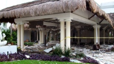 Debris are seen scattered in the lawn of the Grand Riviera Princess Hotel in Playa del Carmen, Quintana Roo state, Mexico, Sunday Nov. 14, 2010. A powerful explosion believed to have been caused by an accumulation of gas killed six people, including four Canadian tourists, and injured 15, according to Quintana Roo state Attorney General Francisco Alor. (AP Photo)